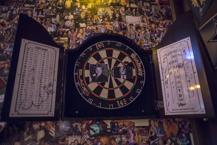 Image: Images of Hillary Clinton and Donald Trump on dart board in Jerusalem