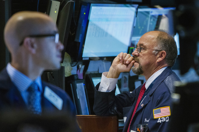 A trader watches the screen at his terminal on the floor of the New York Stock Exchange in New York