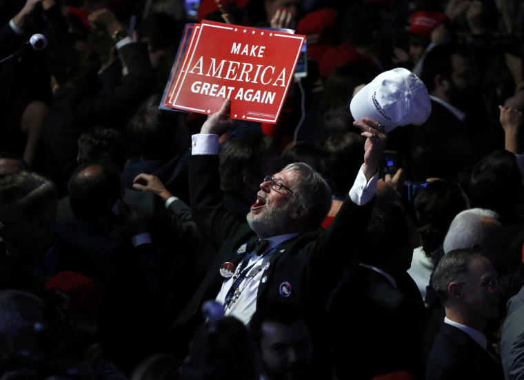 Image: A Trump supporter celebrates as election returns come in at Republican U.S. presidential nominee Donald Trump's election night rally in New York