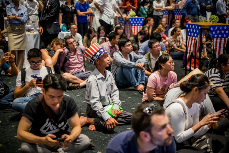 Image:  People watch live election results