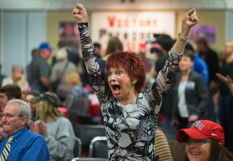 Image: Robin Bernik, who recently moved to Oregon from Florida, watches as her home state is called for Republican presidential candidate Donald Trump
