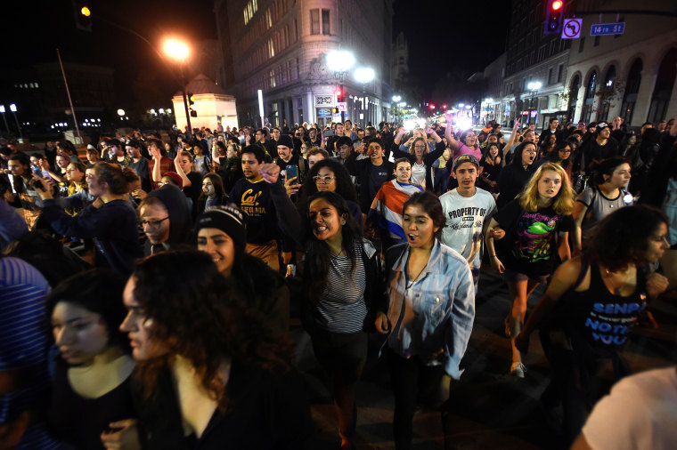 Image: Protesters against president-elect Donald Trump march peacefully through Oakland