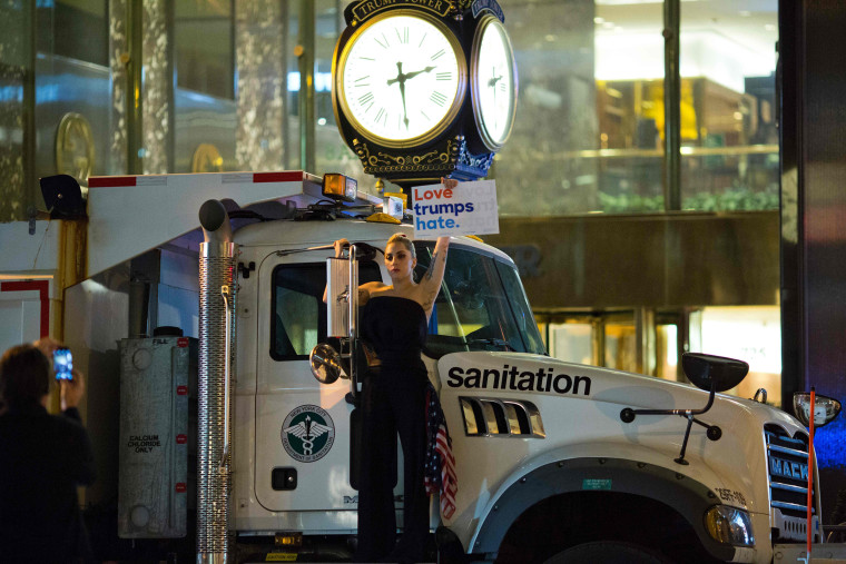 Image:  Musician Lagy Gaga stages a protest against Republican presidential nominee Donald Trump on a sanitation truck outside Trump Tower in New York City after midnight on election day