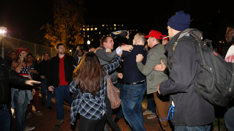 Image:A Hillary Clinton supporter clashes with a Donald Trump supporter outside the White House