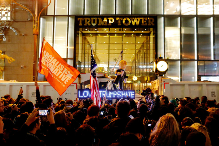 Image: Protesters reach Trump Tower as they march against Republican president-elect Donald Trump in the neighborhood of Manhattan in New York