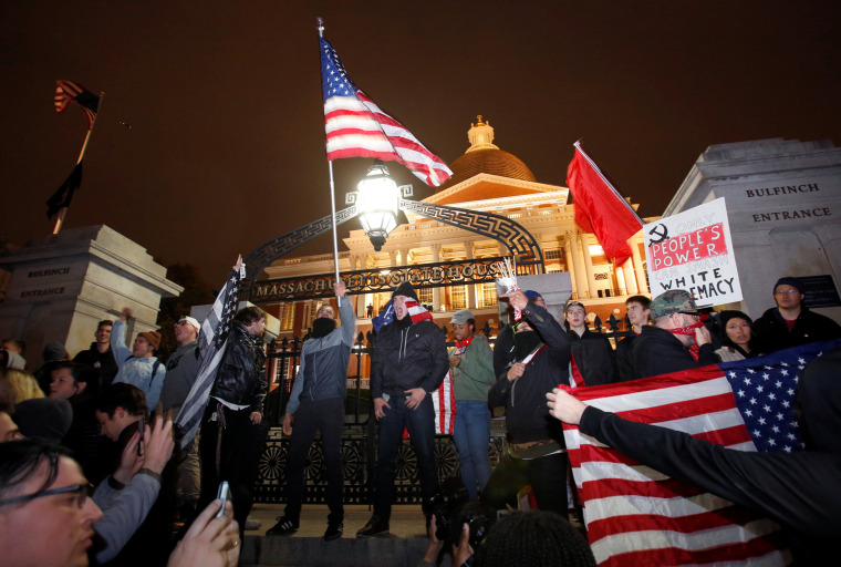 Image: Protesters stand on the state house steps during a march in opposition to the election of Republican Donald Trump as President of the United States in Boston