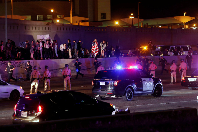 Image: Demonstrators take over the Hollywood 101 Freeway in protest against the election of Republican Donald Trump as President of the United States in Los Angeles, California