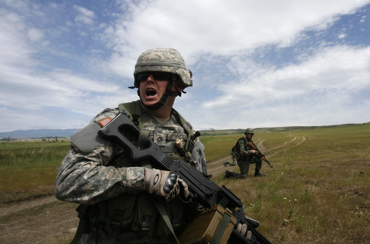 """Image: A U.S. military instructor leads during a NATO exercise named """"Cooperative Lancer 09"""" at Vaziani military base outside Tbilisi"""