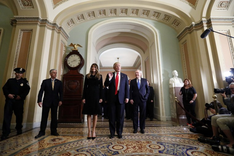 Image: Donald Trump, Melania Turmp, Mitch McConnell