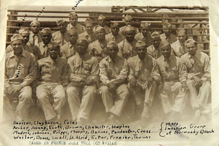 George Davison scrawled the names of his buddies from the 320th on this snapshot taken in Octeville, France in July 1944. Davison noted his place in the back row.