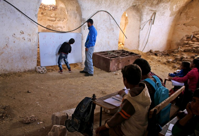 Image: TOPSHOT-SYRIA-CONFLICT-DARAA-EDUCATION-CHILDREN