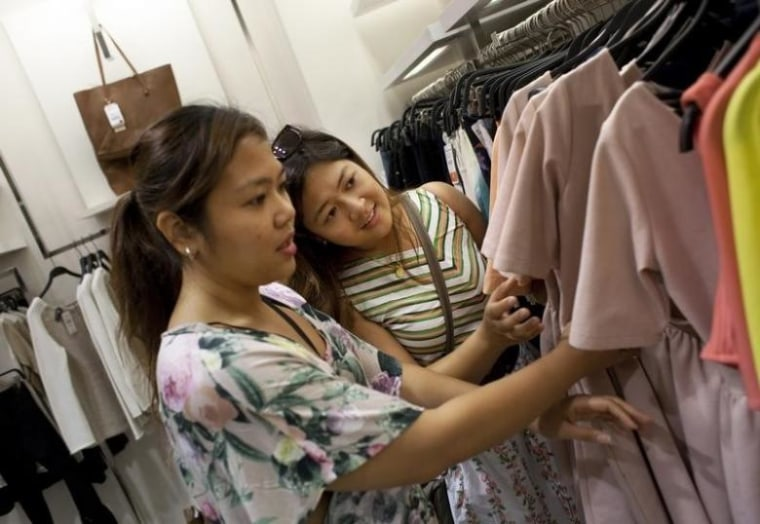 Shoppers browse clothes at a Zara store in Madrid