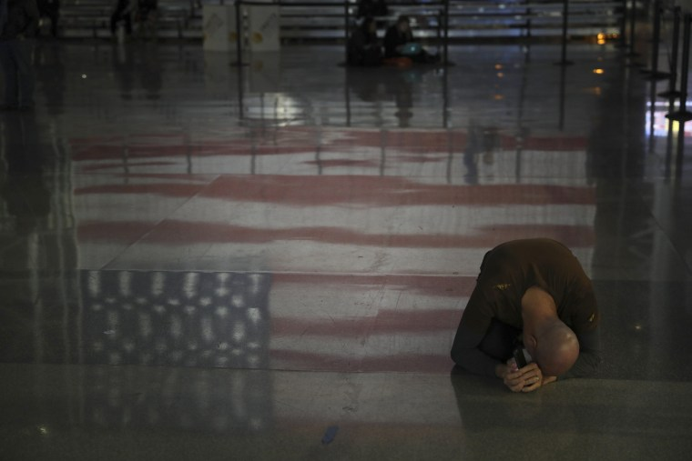 Image: A man mourns after it became clear Hillary Clinton would not reach presidency at the Javits Center in New York.