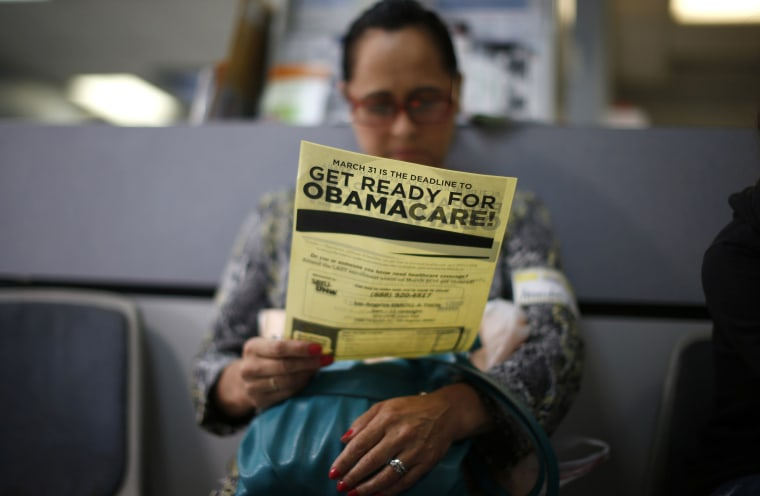 Image: File photo of Murillo reading a leaflet on Obamacare at a health insurance enrollment event in Cudahy, California
