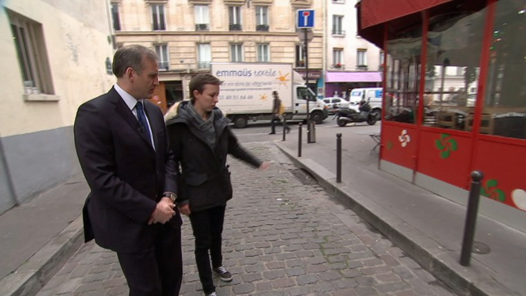 Jonathan Dienst of NBC News (left) outside the Bataclan nightclub in Paris, which is reopening a year after a deadly terror attack, with neighborhood resident Anne Sophie de Chaisemartin. She helped many of the attack victims before first responders arrived.