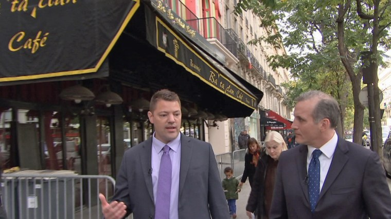 Jonathan Dienst of NBC News (right) outside the Bataclan nightclub in Paris, which has reopened a year after a deadly terror attack, with an NYPD detective.