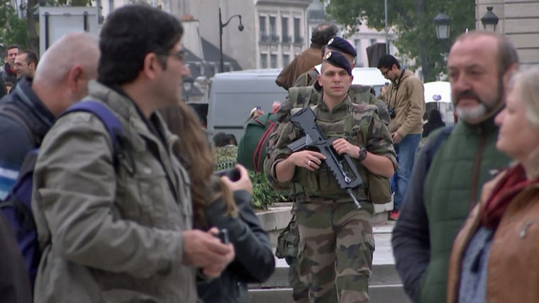 Soldiers and security forces are now a bigger presence in Paris a year after the terror attacks.