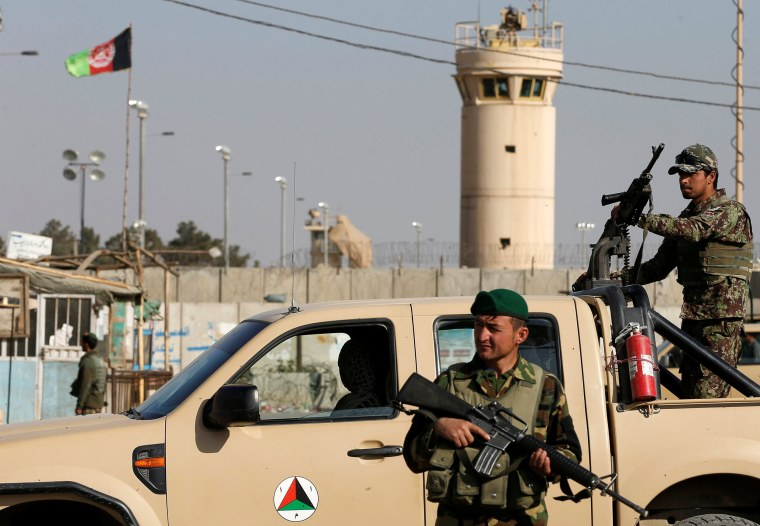 Image: Afghan National Army (ANA) soldiers keep watch outside the Bagram Airfield entrance gate, after an explosion at the NATO air base, north of Kabul