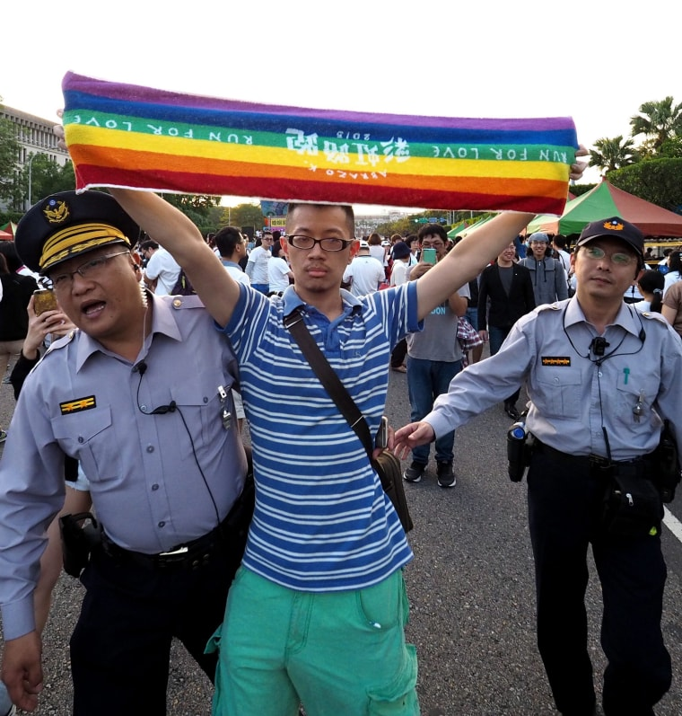 Image: Taiwan pro-family value groups protest against legalizing same-sex marriage