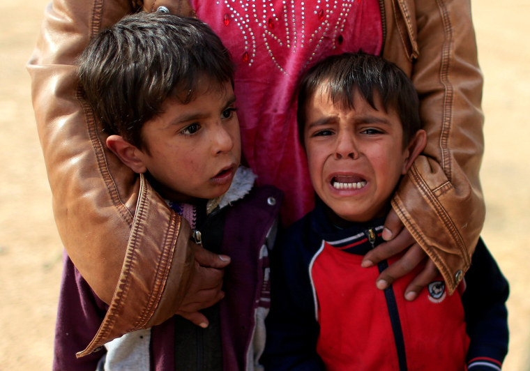 Image: Displaced Iraqi boys cry after their father was killed by a mortar launched by Islamic State militants at Samah neighborhood during a fight between the militants and the Iraqi Counter Terrorism Service, in Mosul, Iraq