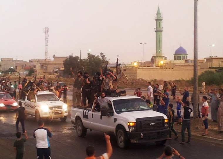 Image: ISIS fighters parade through Mosul, Iraq, on June 25