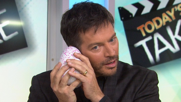 What's going on in there? Harry Connick Jr. waits for the Hatchimal egg to crack.