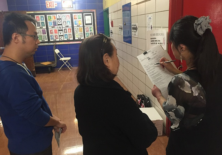 Volunteers from the Asian American Legal Defense and Education Fund conduct exit polling at PS 126 in Manhattan on April 20, 2016.
