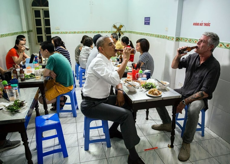 """White House photographer Pete Souza posted this image of President Barack Obama on Instgram with the caption, """"Beers and dinner with Anthony Bourdain last night in Hanoi."""""""