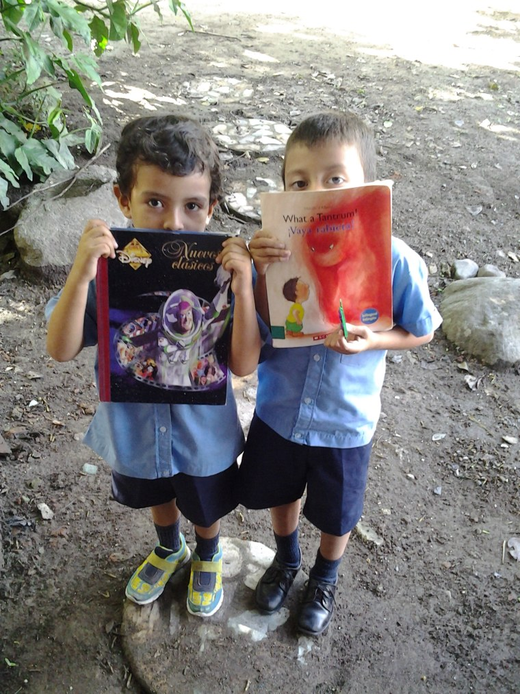 Students show their new books in San Jacinto, El Salvador.
