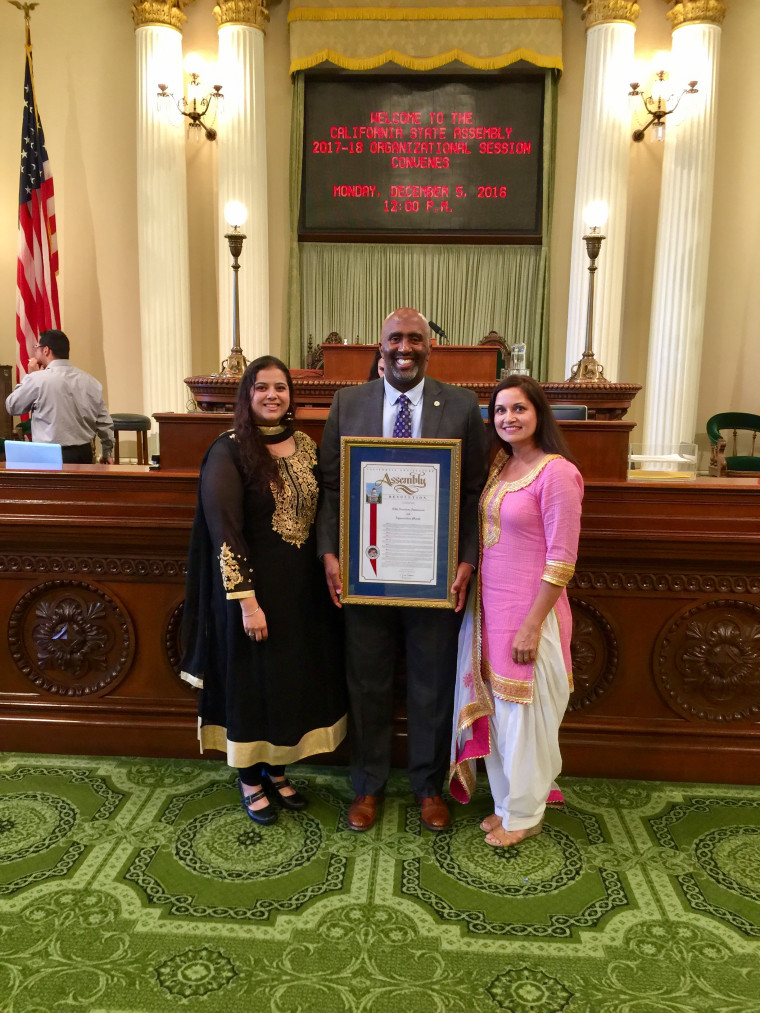 Harjit Kaur, Assemblymember Jim Cooper, and Goldy Shergill with the resolution declaring November Sikh Awareness and Appreciation Month.