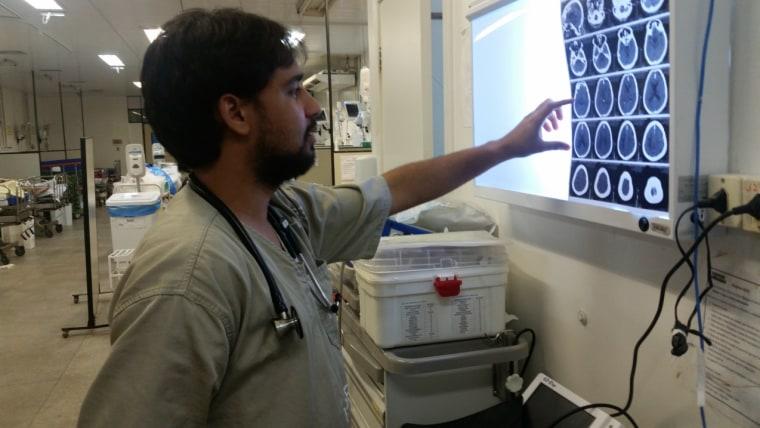 Dr. Mateus do Ros?rio evaluating a patient with neurological complications of Zika virus infection at Roberto Santos Hospital, Salvador-Brazil