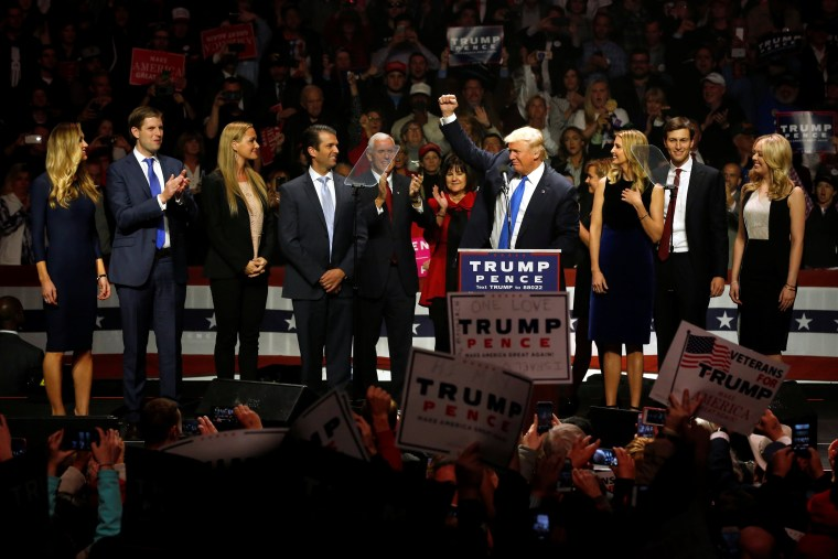 Image: Trump, Pence and their families rally with supporters at an arena in Manchester, New Hampshire
