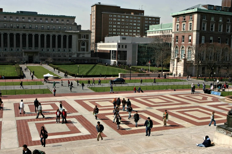 Students walk across the campus of Columbia University in Ne