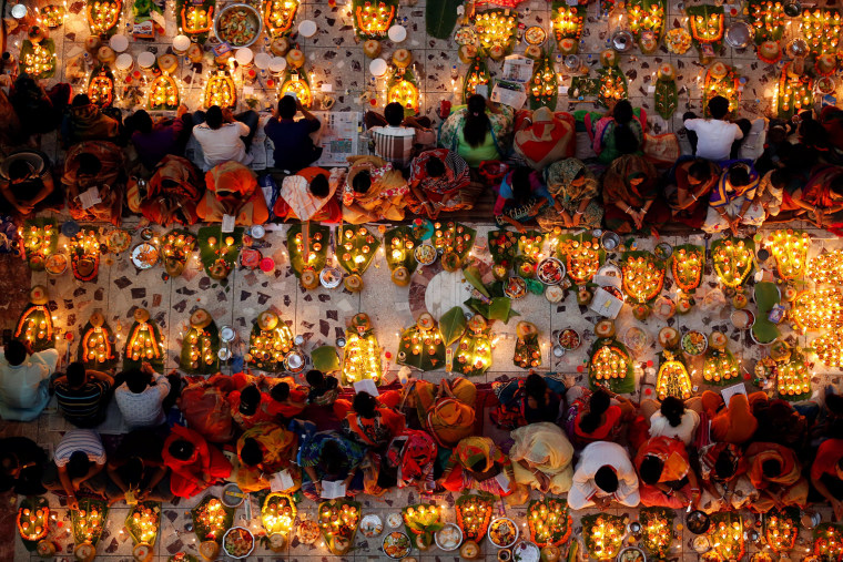 Image: Hindu devotees sit together on the floor of a temple to observe Rakher Upabash for the last day, in Dhaka, Bangladesh