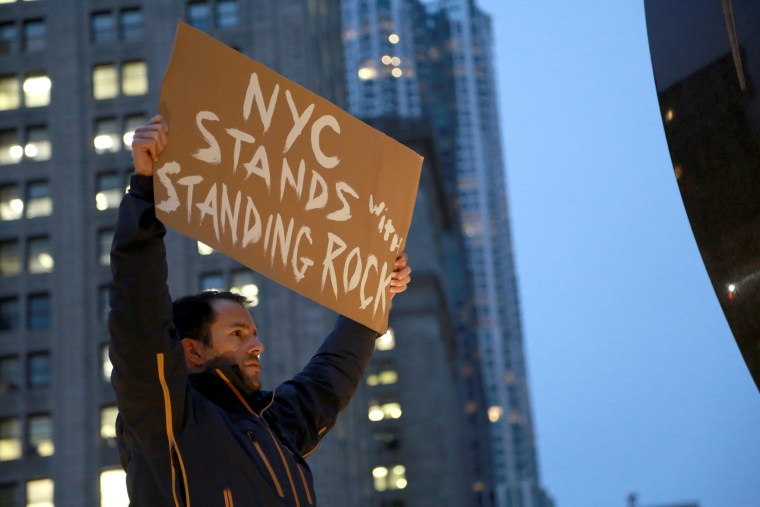 """A demonstrator in New York City's Foley Square holds a sign to express his solidarity with the Standing Rock Sioux Indian Tribe in a """"No DAPL National Day of Action"""" that inspired protests around the country. Nov. 15."""