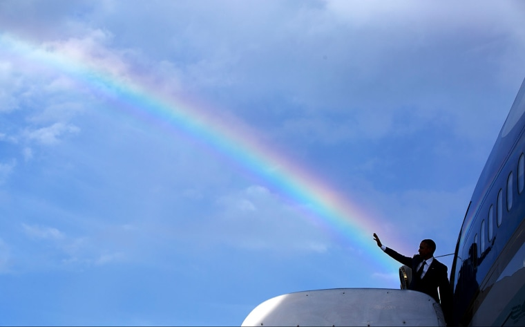 The President's wave aligns with a rainbow as he boards Air Force One at Norman Manley International Airport prior to departure from Kingston, Jamaica, April 9, 2015.