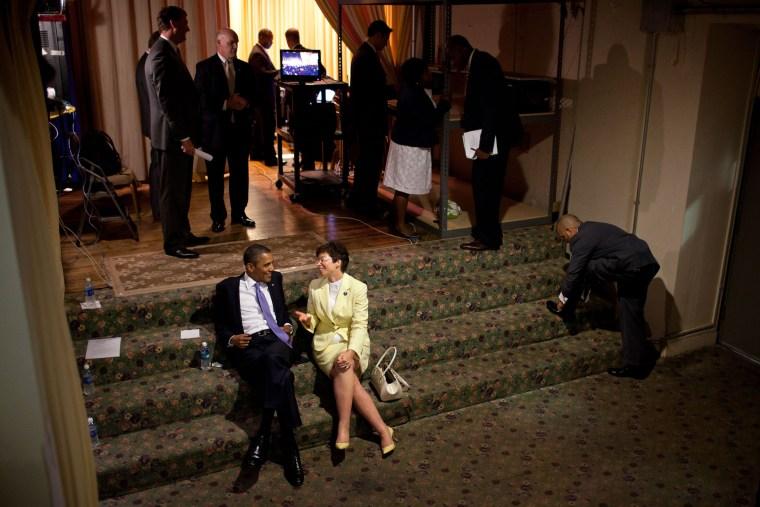 President Barack Obama talks backstage with Senior Advisor Valerie Jarrett before a reception at the Hyatt at the Bellevue in Philadelphia, Pennsylvania, June 30, 2011.