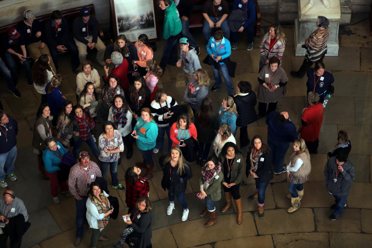 Image: Visitors are seen at the rotunda floor of the rebuilt cast-iron dome of the U.S. Capitol