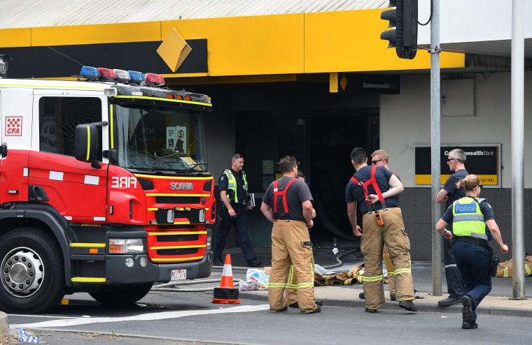 Image: Emergency crews after fire at a bank in Melbourne, Australia