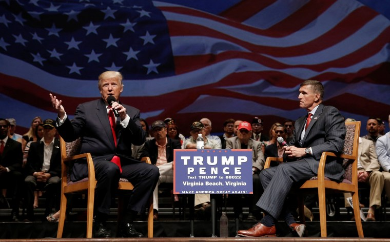 Image: Republican presidential nominee Donald Trump speaks along side retired U.S. Army Lieutenant  General Mike Flynn during a campaign town hall meeting in Virginia Beach, Virginia