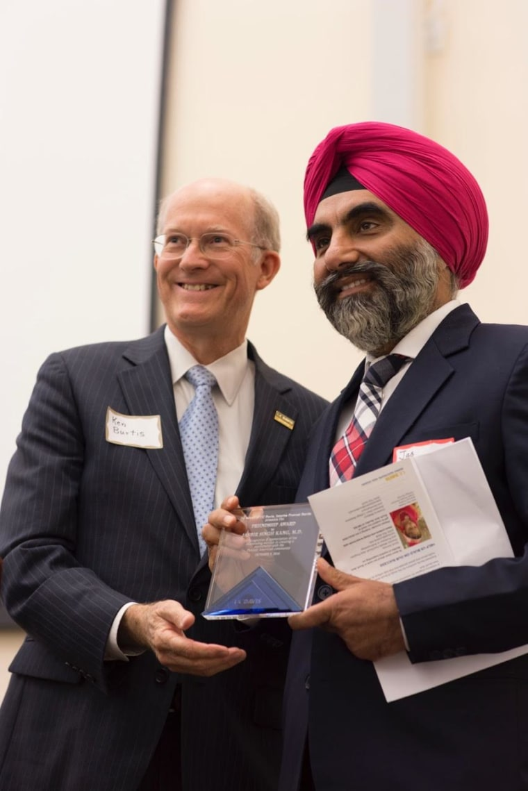 UC Davis Provost Kenneth Burtis presents Dr. Jasbir Singh Kang with an award honoring his work for the Punjabi American community at a launch event on October 8 for the Pioneering Punjabis Digital Archive.