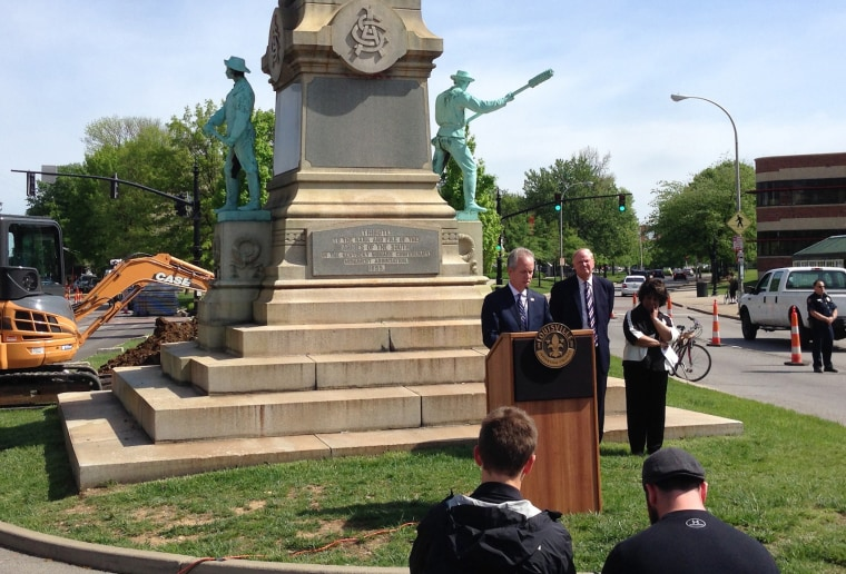 Louisville Mayor Greg Fischer speaks in front of the Confederate monument near the University of Louisville with the university president, James Ramsey, left, in Louisville, Kentucky, April 29, 2016.