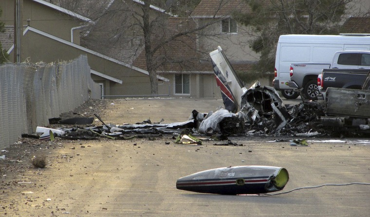 The wreckage of an American Medflight plane sits in the Barrick Gold Corp. parking lot  in Elko, Nev., Saturday, Nov. 19, 2016.