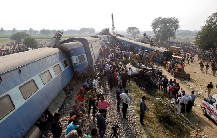 Image: Rescue workers search for survivors at the site of a train derailment in Pukhrayan, south of Kanpur city, India