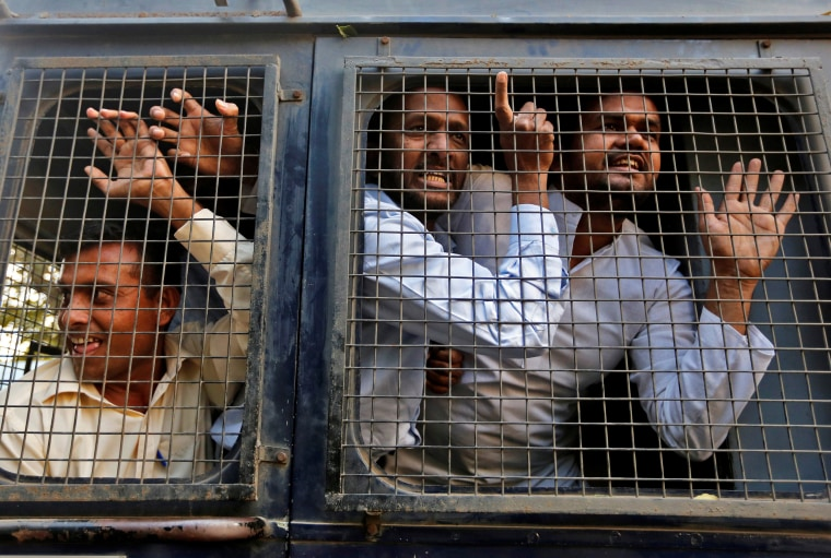 Image: Supporters of India's main opposition Congress party shout slogans after being detained by the police in Ahmedabad