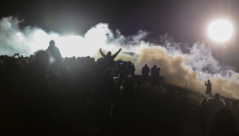 Image: Police tear gas protesters during a protest against plans to pass the Dakota Access pipeline near the Standing Rock Indian Reservation, near Cannon Ball, North Dakota, U.S.