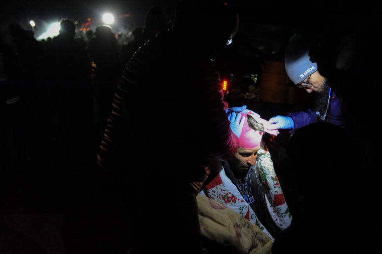 Image: A protester is given medical attention during a protest against plans to pass the Dakota Access pipeline near the Standing Rock Indian Reservation, near Cannon Ball, North Dakota, U.S.
