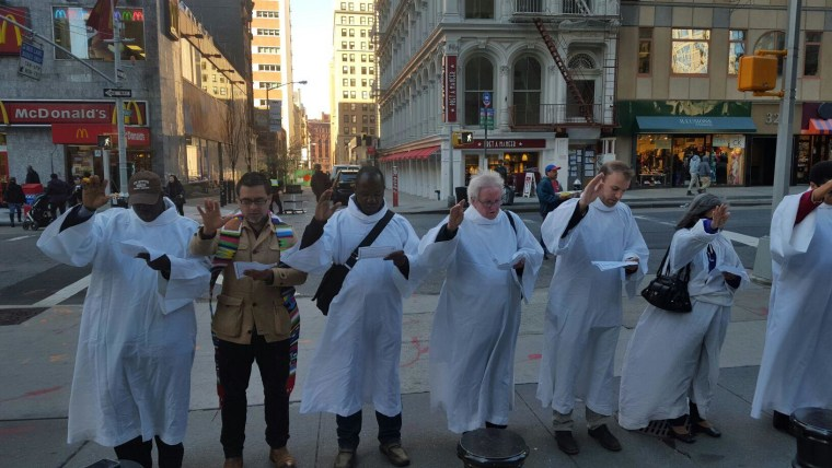 Interfaith leaders participate in the Jericho Walk around immigration services building in Federal Plaza.