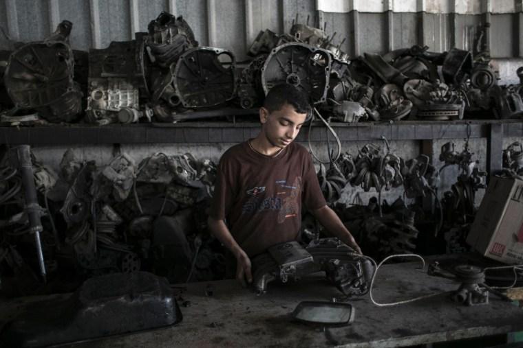 Image: TOPSHOT-PALESTINIAN-CONFLICT-GAZA-ECONOMY-CHILD LABOUR