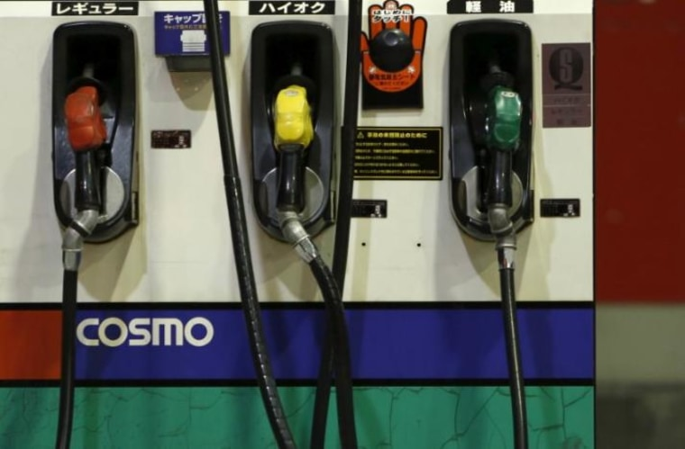 Petrol nozzles are seen at Cosmo Energy Holdings' Cosmo Oil service station in Tokyo